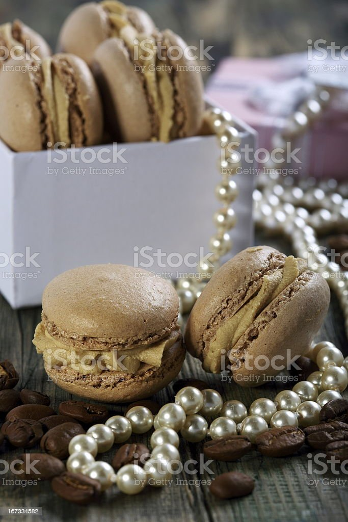 Macaroons in the box, pearls and coffee beans. royalty-free stock photo