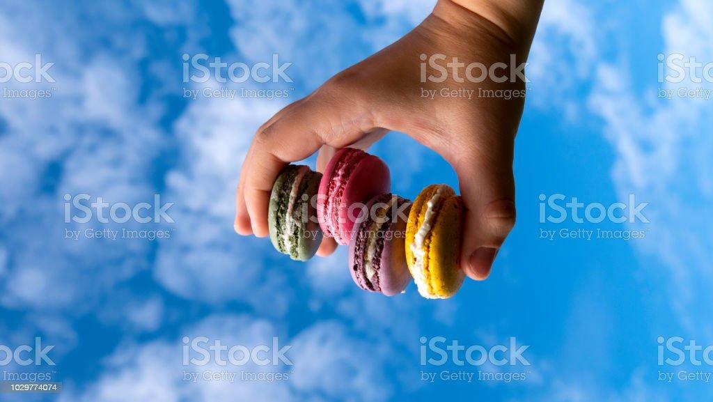 macaroons on sky background stock photo