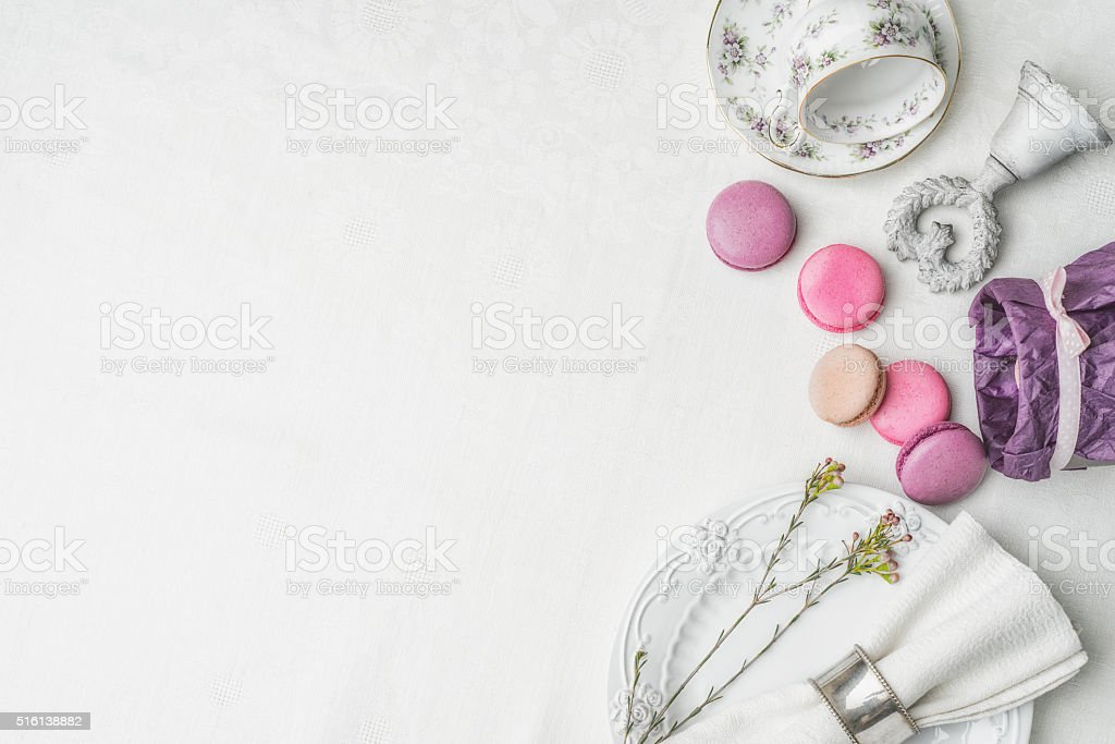 Macaroons with flowers and decorations  at  right of white cloth stock photo