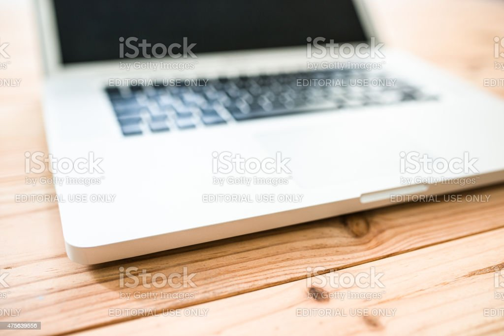 Macbook Pro Laptop on the desk stock photo