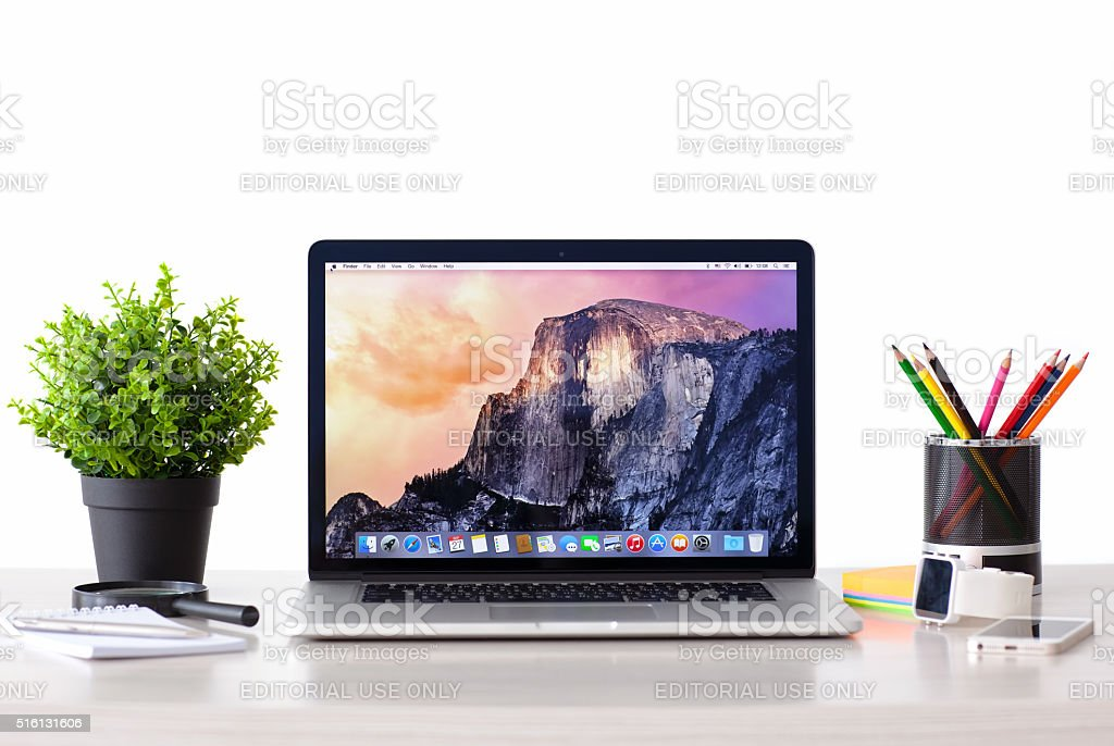 MacBook with OSX Yosemite the screen on the table stock photo