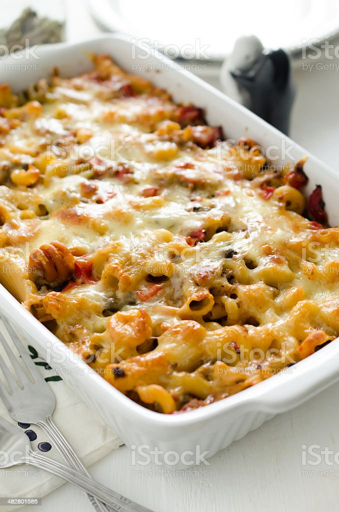 Maccaroni casserole with tuna, mushroom, red bell pepper and cheese stock photo