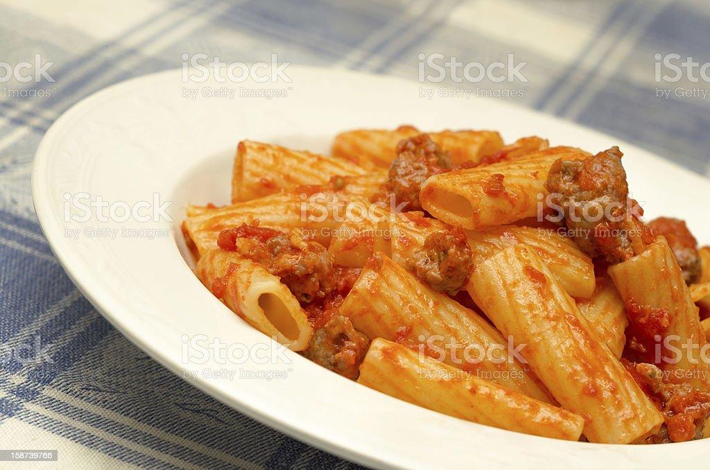 Maccheroni with tomato and sausage sauce royalty-free stock photo