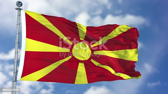 1056280906istockphoto Macedonia Flag in a Blue Sky 940324532