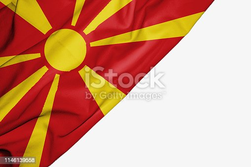 1056280906istockphoto Macedonia flag of fabric with copyspace for your text on white background 1146139558