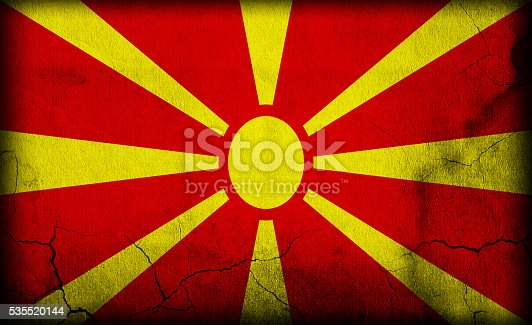 935056316 istock photo Macedonia flag on stone 535520144