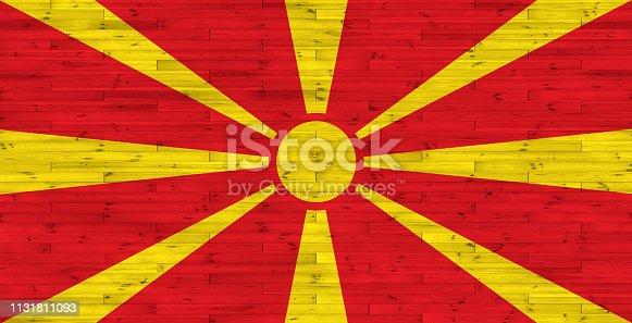 1056280906 istock photo Macedonia flag on wood texture 1131811093