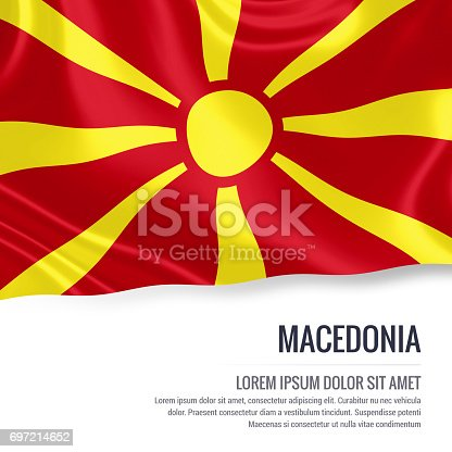 1056280906istockphoto Macedonia flag. Silky flag of Macedonia waving on an isolated white background with the white text area for your advert message. 3D rendering. 697214652