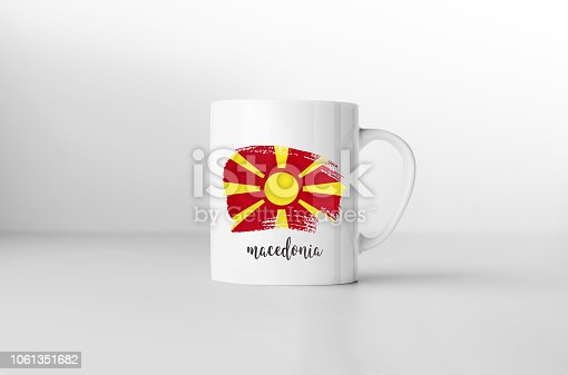 1056280906istockphoto Macedonia flag souvenir mug on white background. 3D rendering. 1061351682