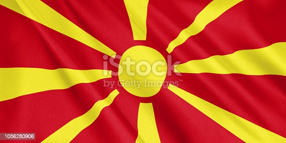 1056280906istockphoto Macedonia flag waving with the wind, wide format, 3D illustration. 3D rendering. 1056280906