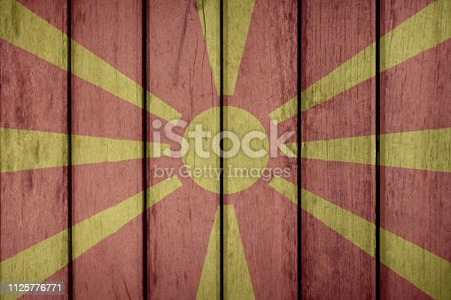 935056316 istock photo Macedonia Flag Wooden Fence 1125776771
