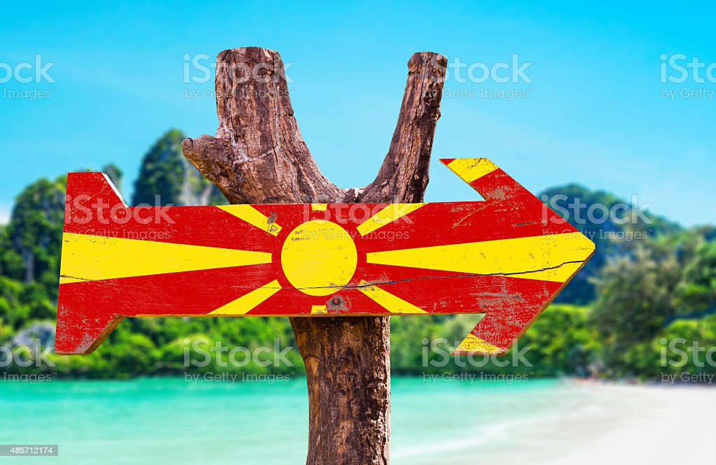 Macedonia Flag wooden sign with lake background stock photo