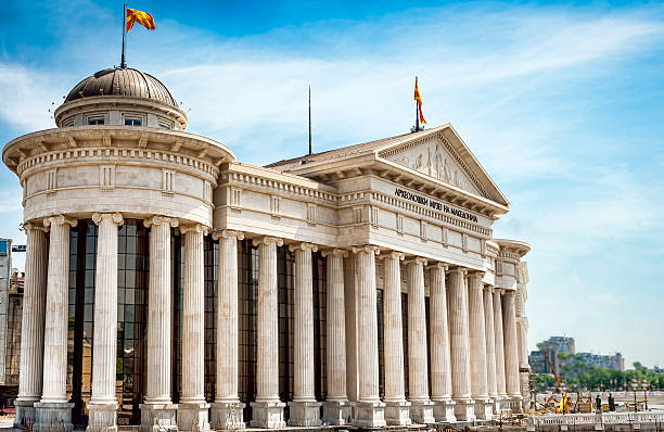 Macedonian archeological museum building in Skopje, Macedonia FYR Macedonian archeological museum in Skopje, Former Yugoslav Republic of Macedonia (FYR) - colossal greek style building with pillars, dome and national flag. greco roman style stock pictures, royalty-free photos & images