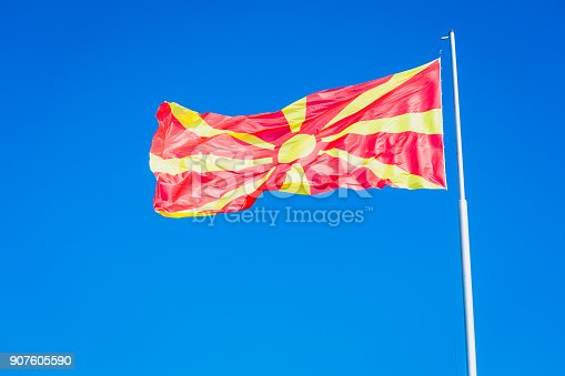 1056280906istockphoto Macedonian Flag waving in the wind. Ohrid lake, Macedonia, Europe 907605590
