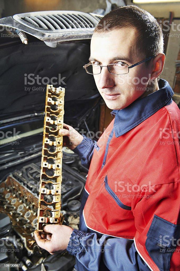 machanic repairman at automobile car engine repair royalty-free stock photo