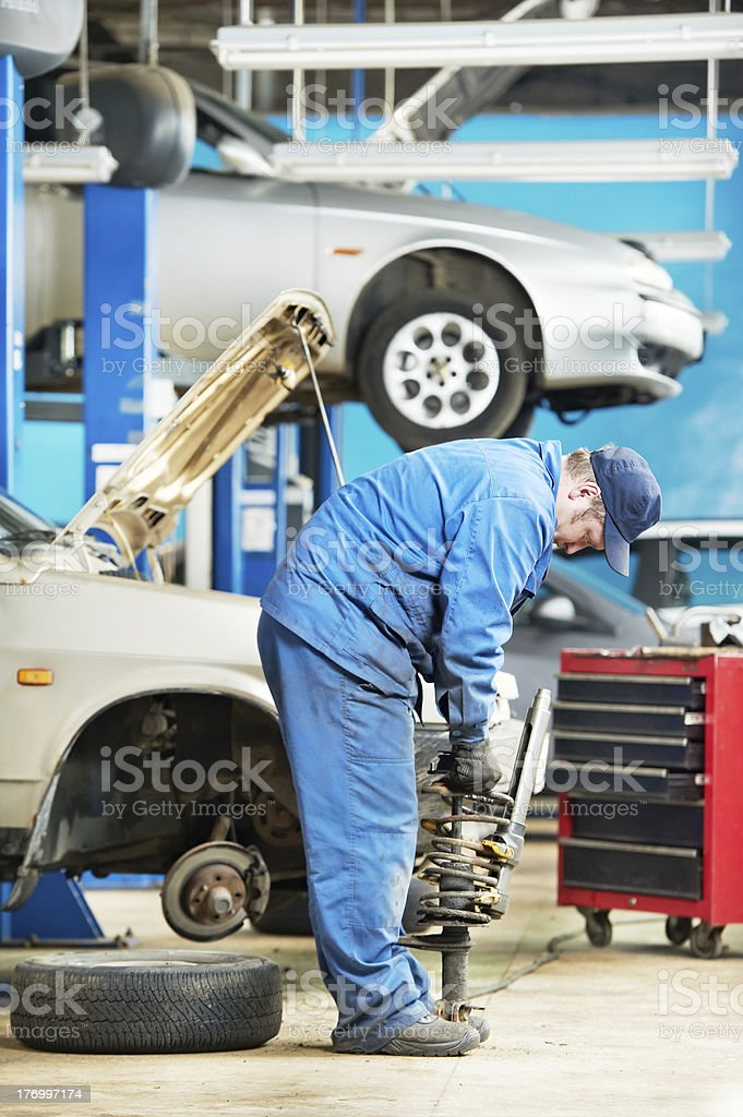 machanic repairman at carriage spring adjustment royalty-free stock photo