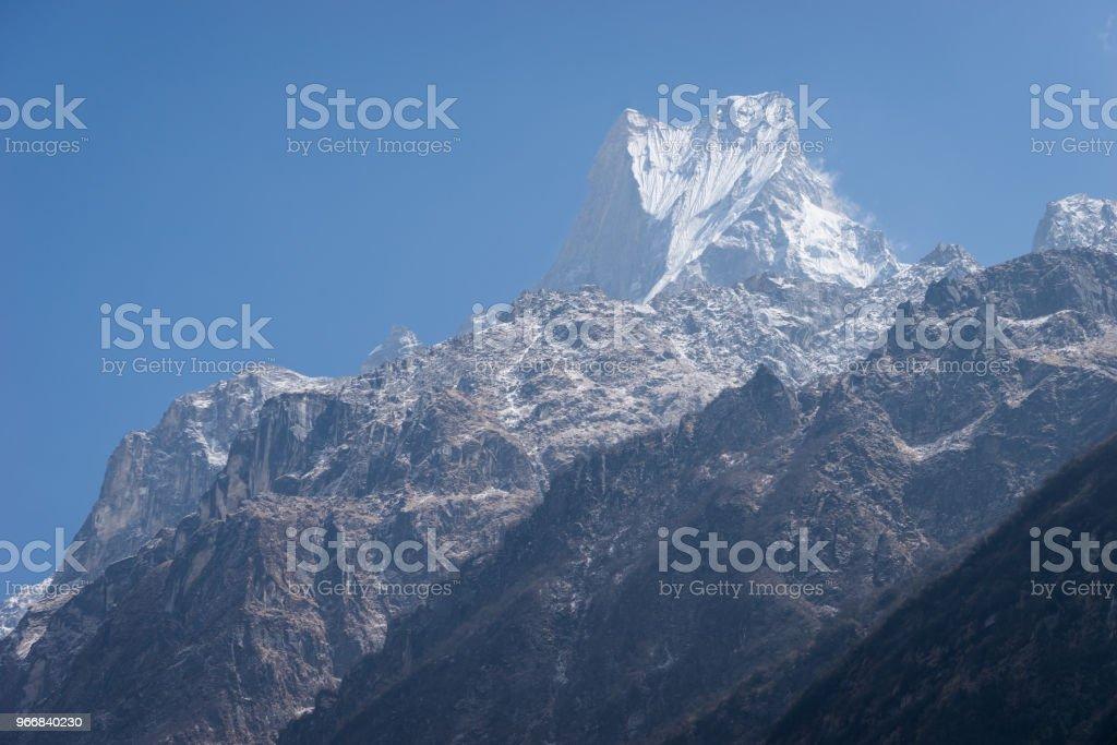 Machapuchre mountain peak, holy peak in Annapurna mountain range,...
