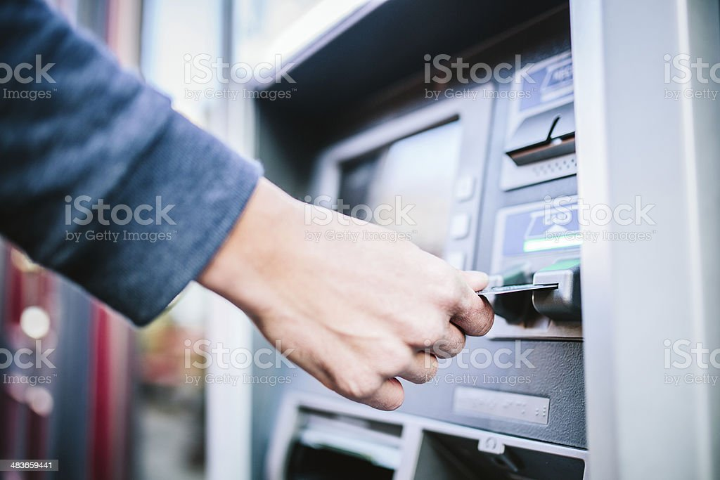 ATM Machine and Mans Hand stock photo