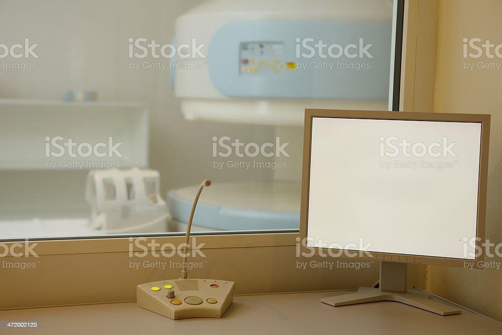 MRI machine and screens stock photo