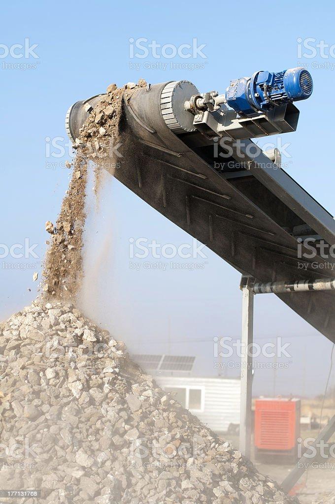 Machine for crushing stone stock photo