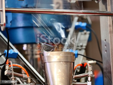 istock Machine for packing food bag products 1134728605