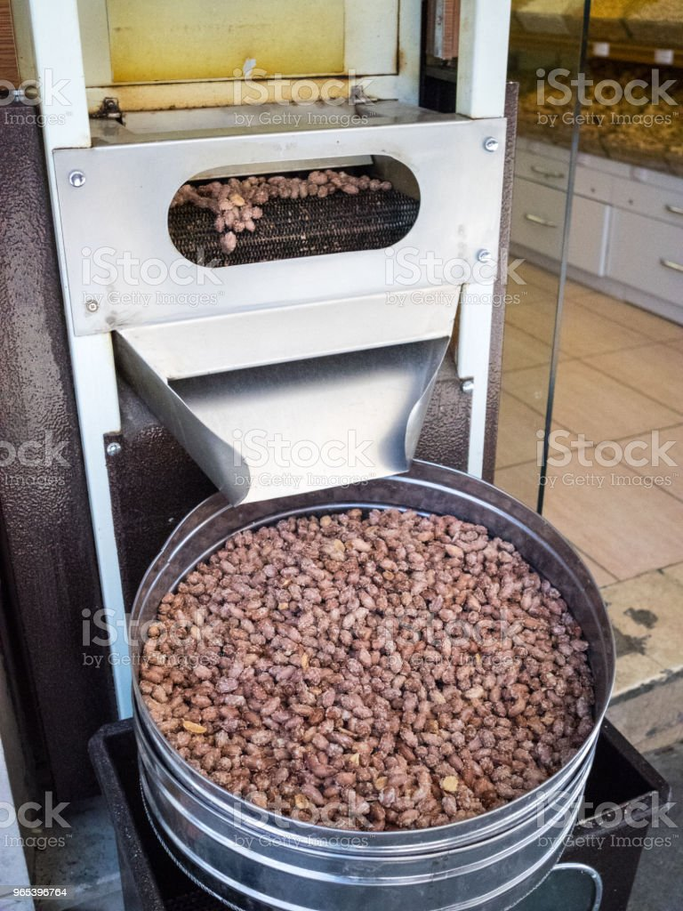 Machine for roasted nuts on street markets in old cities of Turkey. zbiór zdjęć royalty-free