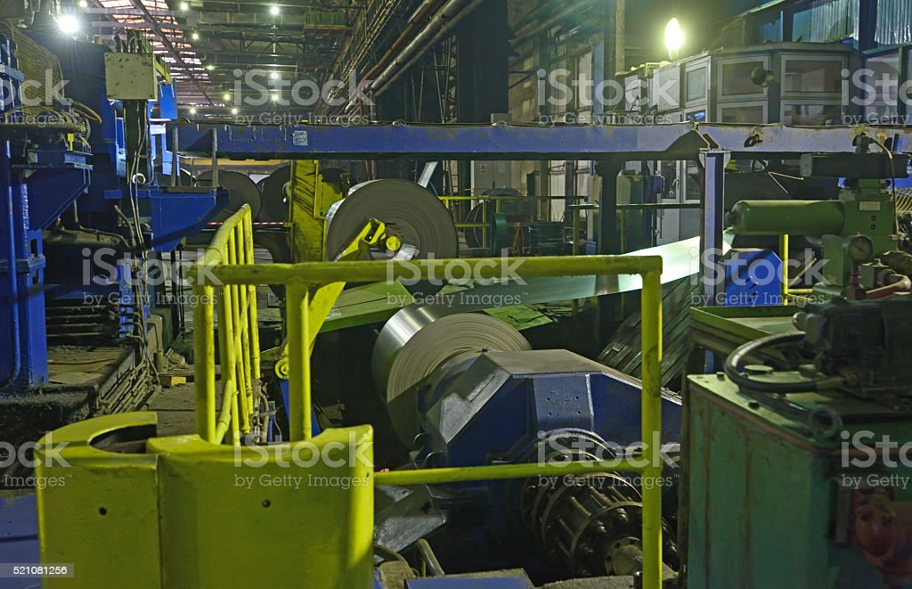 machine for rolling steel coil stock photo
