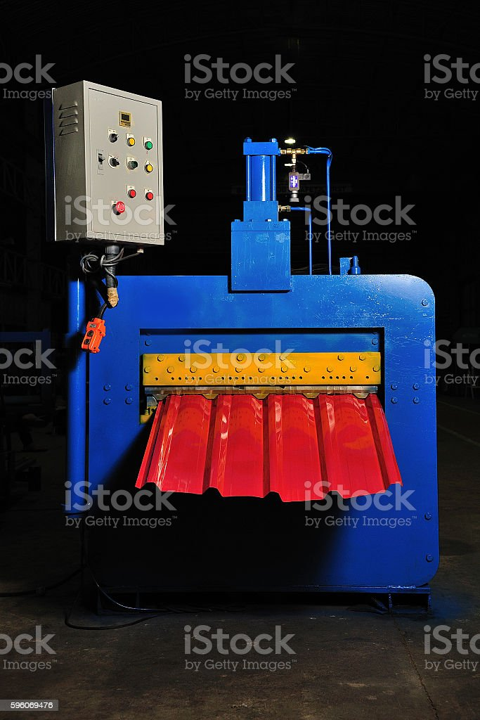 machine for rolling steel sheet in warehouse, Cold rolled steel stock photo