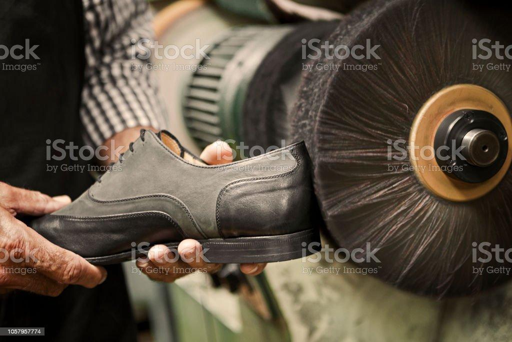 Machine for shoe polishing stock photo