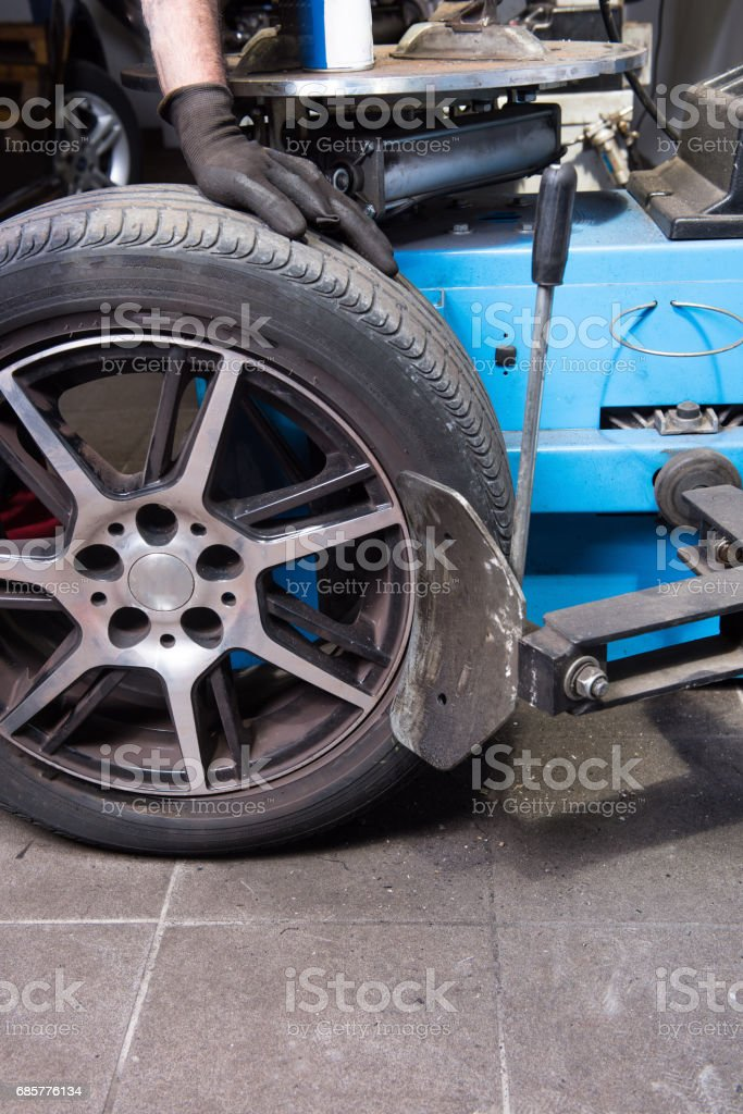 Machine for the tyre change in a car repair royalty-free stock photo