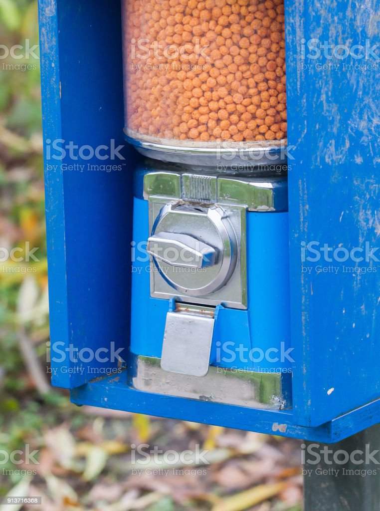 Machine for tourists - Paying to feed the animals stock photo