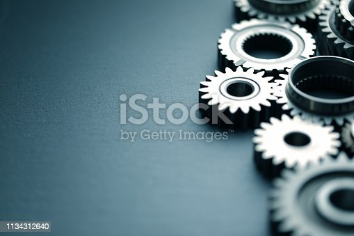 Mechanical gears on black slate background