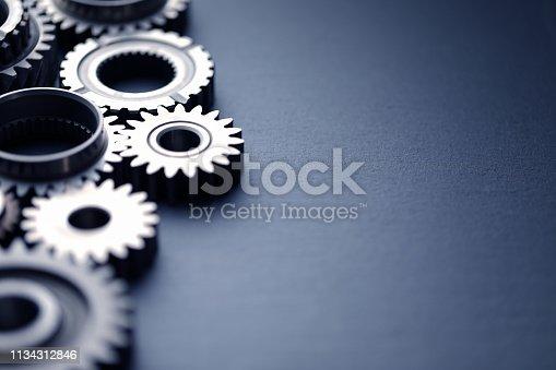 Mechanical gears on black slate background