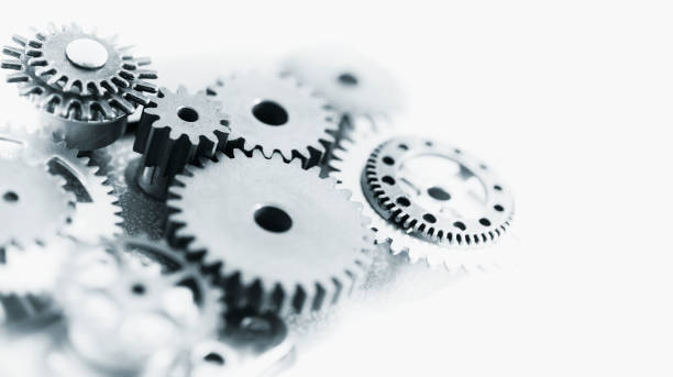 Machine Gears Mixed machine gears with copy space. samenwerking stock pictures, royalty-free photos & images