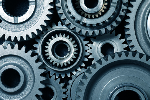 Mechanical gear combination close-up; blue tone top view
