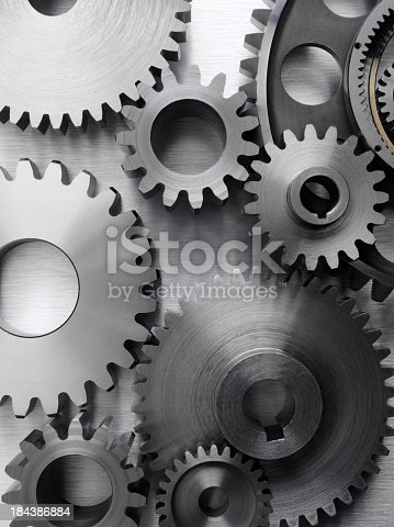 Engineering machine cogs and gears on a stainless steel background Teamwork conceptClick on the link below to see more of my business images