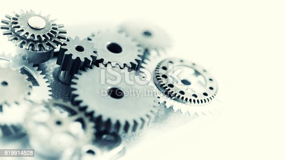 Close up of metal cogs. Toned Image.