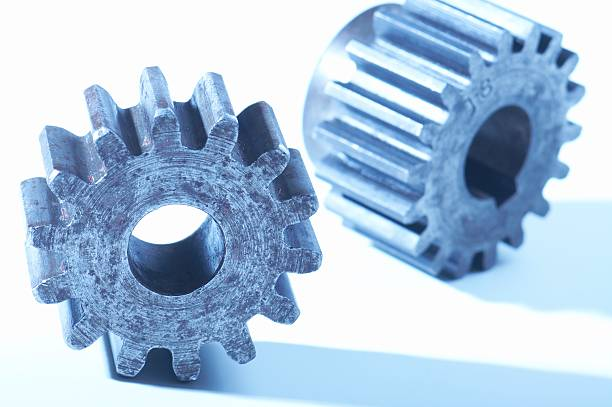 """machine gears, tungsten white balance, inaltered from raw file """"Heavy machine gears, disconnected, blue tint, isolated on white. You may also like:"""" disjointed stock pictures, royalty-free photos & images"""