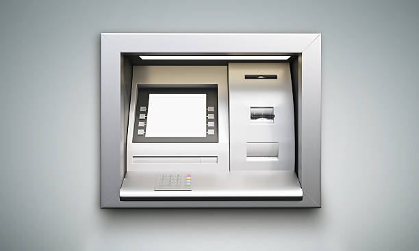 ATM machine grey background stock photo