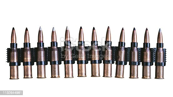 istock machine gun ammo on a white background, bullet belt, bandoleer, chain of ammo on wooden background,cartridge 7.62 mm caliber, top view, isolated on white background 1132644981