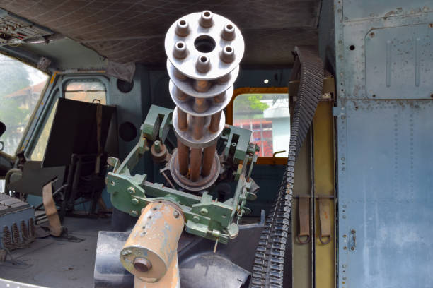 Machine gun m134 in old American helicopter at the War Remnants Museum in Vietnam, Ho Chi Minh city Machine gun m134 in old American helicopter at the War Remnants Museum in Vietnam, Ho Chi Minh city viet cong stock pictures, royalty-free photos & images