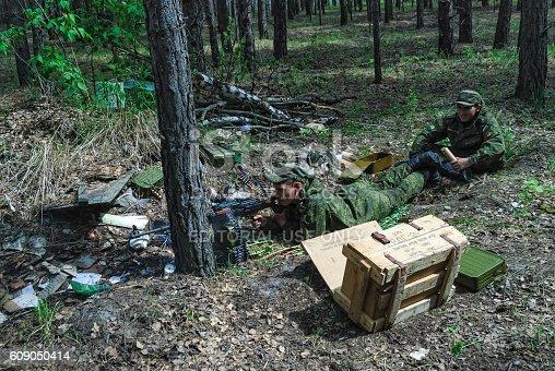 istock Machine gunners ambush in forest 609050414