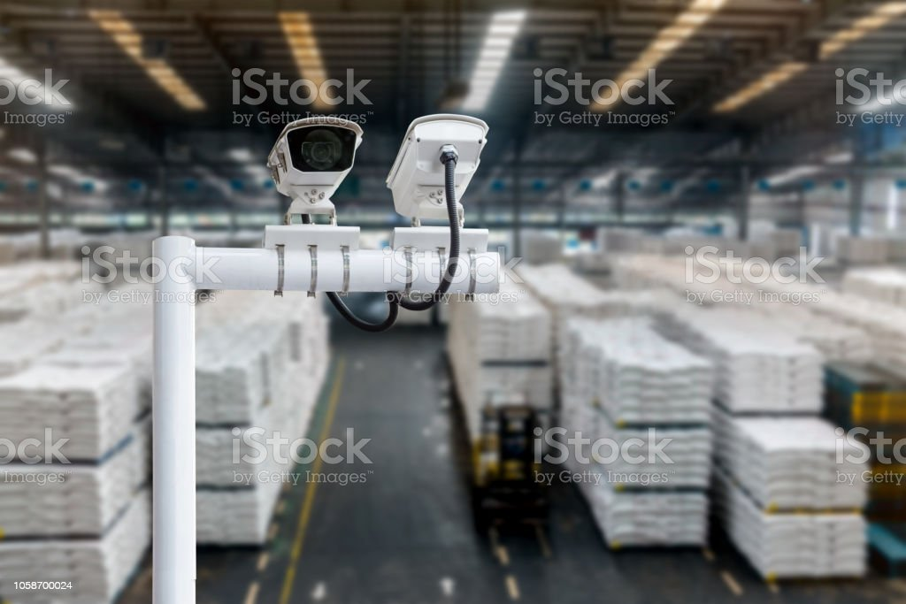 Machine Learning analytics identify person technology , Artificial intelligence concept. Cctv , security camera and Software ui analytics behavior and face recognition people in smart factory. stock photo