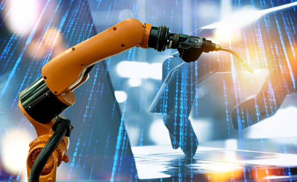 Machine learning and artificial intelligence technology concept. Blue tone of binary coded number and robot hand , laptop and automate wireless spot welding machine robot arm in smart factory. stock photo