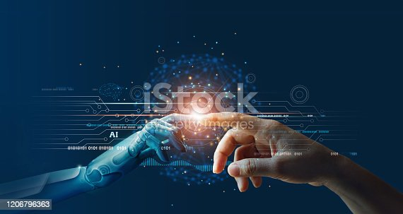 istock AI, Machine learning, Hands of robot and human touching on big data network connection background, Science and artificial intelligence technology, innovation and futuristic. 1206796363