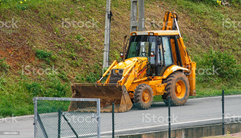 JCB machine on the road stock photo