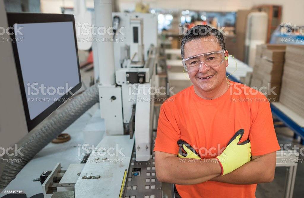Machine operator at a wood factory stock photo