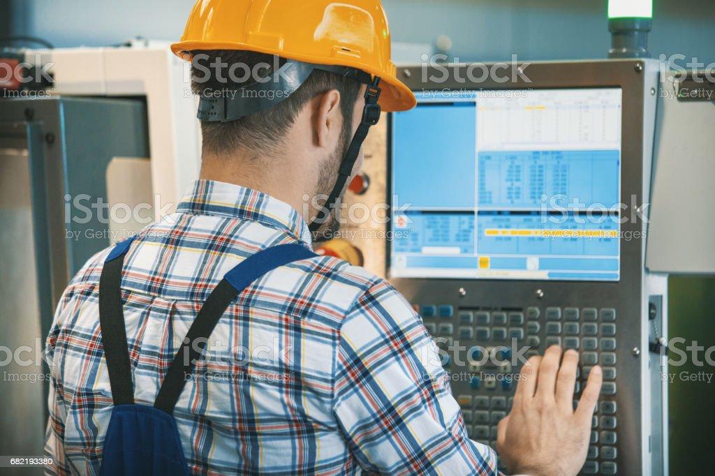 CNC machine operator. stock photo