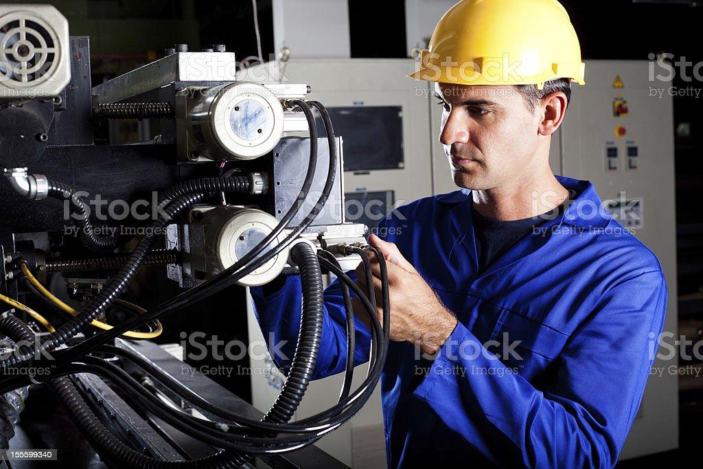 machine operator working stock photo