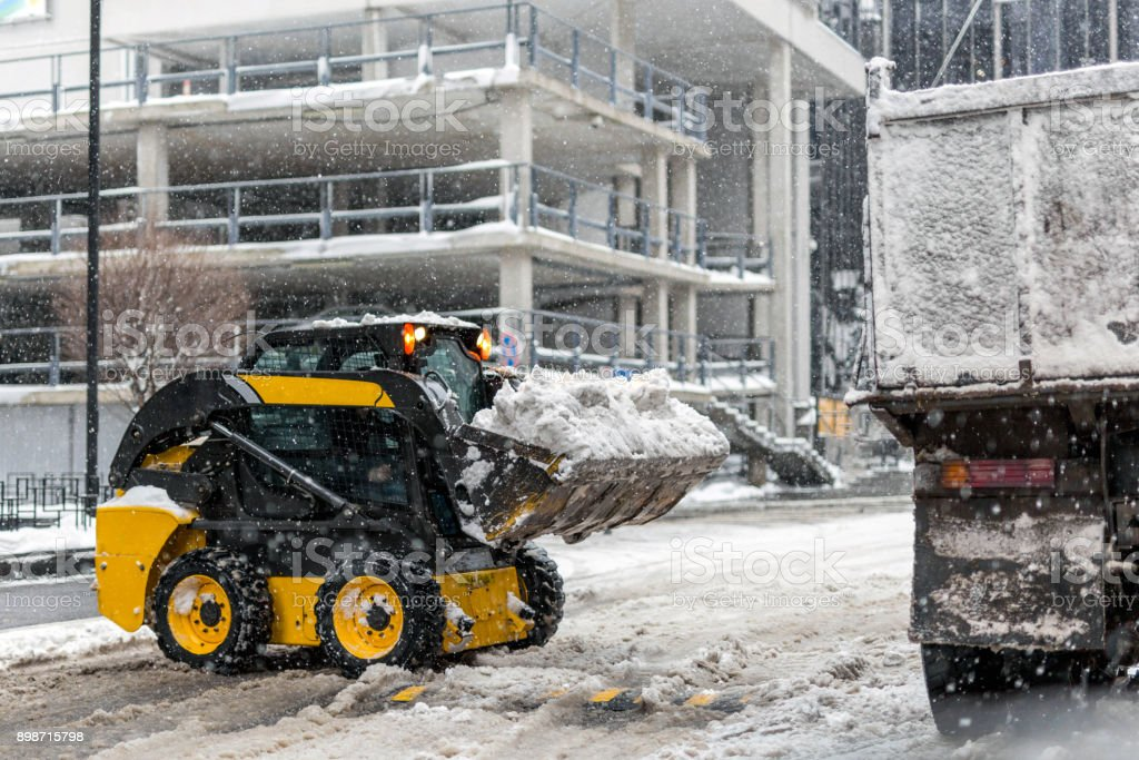 Machine Remove Snow From A City Street Stock Photo